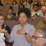 woman in lavender blouse speaks from audience at Chocolate Milk screening