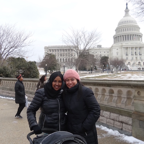 2 women with a stroller in front of the US Capitol