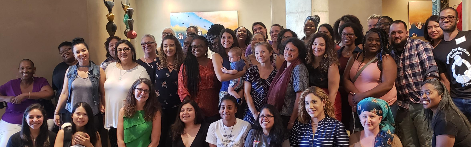 a diverse crowd of birth workers posed together